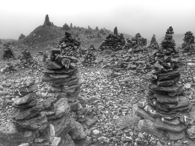 The KIOMI Collection Rocks Rock Pile Switzerland Alps Mountains Rain Mist In The Clouds Stone Stones Stone Pile