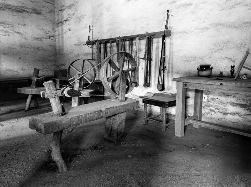 Spinning wheel room in black and white at La Purisima Mission in Lompoc, California. La Purisima Lompoc California