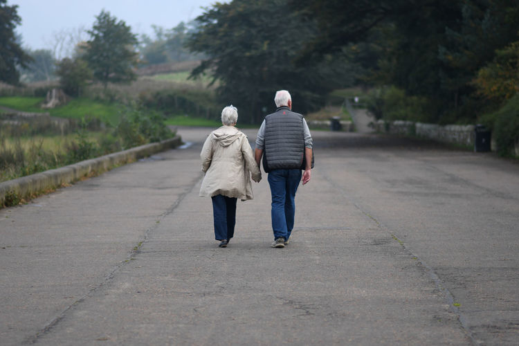 Rear View Walking Full Length Two People The Way Forward Men Real People Direction Lifestyles Tree Togetherness People Love Bonding Footpath Positive Emotion Outdoors Couple - Relationship Love Pensioners Old Age