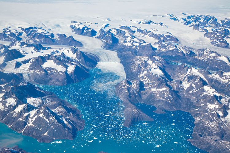 High angle view of snowcapped mountains and sea