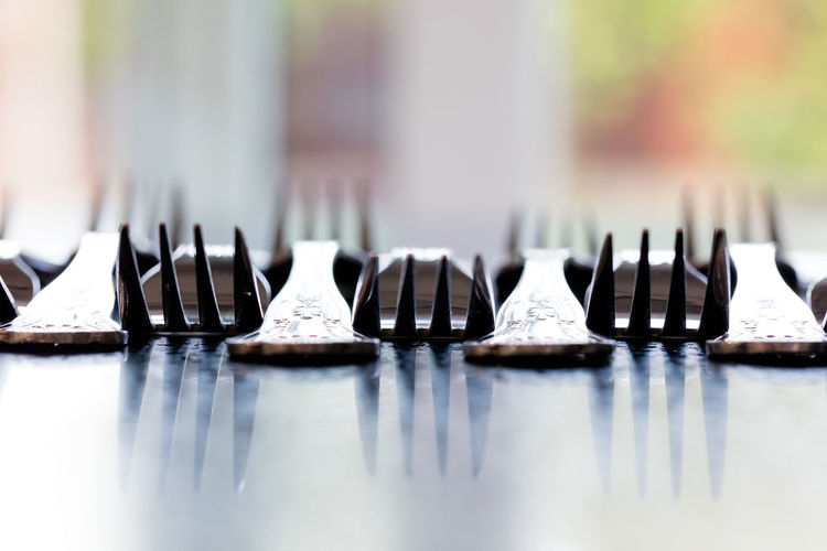 Close-up of forks on table
