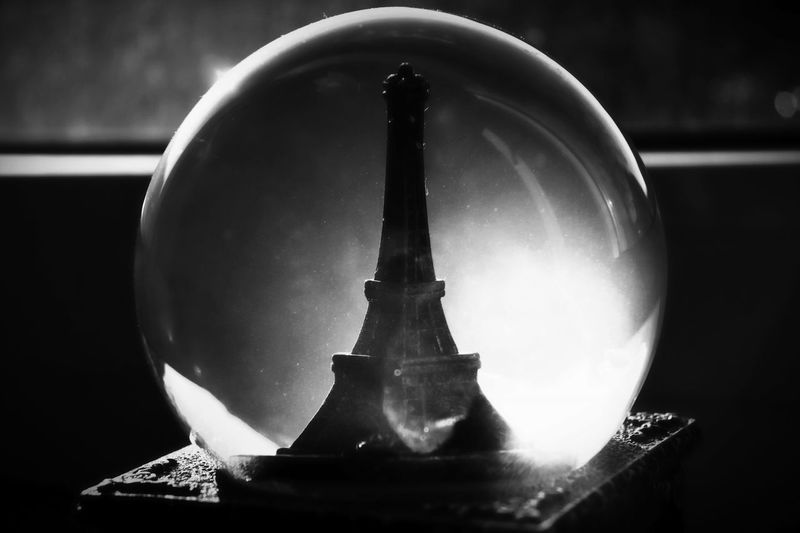 Forgotten souvenir Black And White Snow Globe Canon Eos 200d Morten Müller-Schnelle Musik Box Eiffel Tower Paris Souvenir Close-up No People Transparent Indoors  Focus On Foreground Glass - Material Illuminated Window Reflection Glass