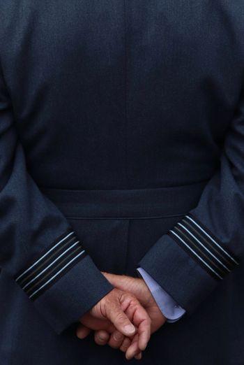 Rear view of man wearing uniform
