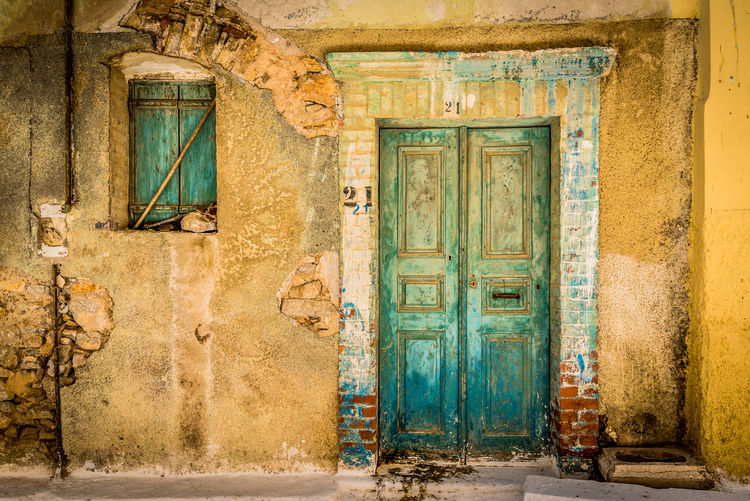 By Anna Wacker Door Entrance Architecture Building Exterior Building Built Structure Old No People Abandoned Closed Window House Day History Weathered Wall - Building Feature The Past Outdoors Travel Destinations Run-down Deterioration Abandoned & Derelict Decayed Beauty Dilapidation