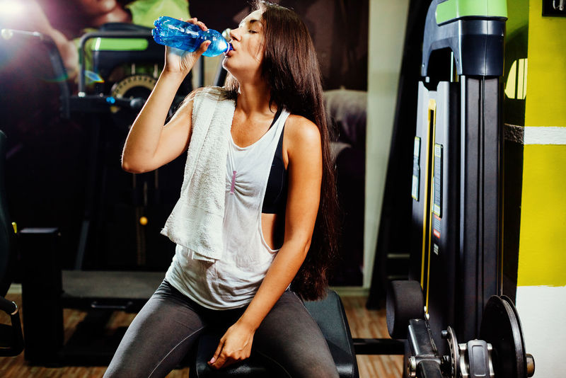 fitness woman drink water in gym. Fitness model with bottle of water Diet Drinking Water EyeEm Best Shots Females Thirsty  Day Fitness Fitness Model Fitness Training Fitnessmodel Gym Indoors  Lifestyles Long Hair One Person People Real People Sexygirl Sport Sports Sports Clothing Water Water Drinking Young Adult Young Women