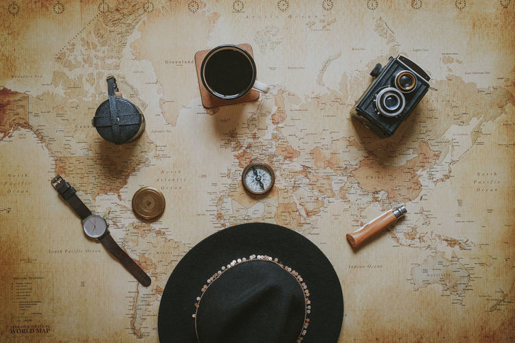Explorer's gear Hat Map Planning Travel Coffee Coffee - Drink Compass Directly Above Equipment Explorer Flatlay Gear High Angle View Indoors  Journey No People Still Life Vintage Camera Watch World Map