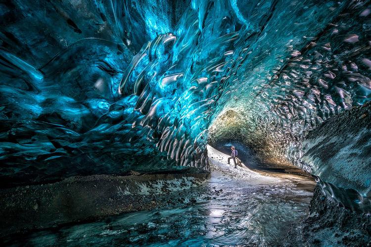 Man standing in frozen cave