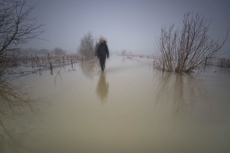 Walking on Water Water Reflections Flooding Fine Art Photography Landscape Moody Sky Landscape_photography Beautiful Nature Northamptonshire That's Me Walking Blurred Motion Ghostly Winterscapes Waterscape Waterfront Floodwaters Check This Out Monochrome Monochromatic Monoart Color Palette People And Places