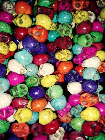 Skulls Premium Collection Skulls Bone  Hand Carved Skulls And Bones Beads Multi Colored Full Frame Backgrounds Choice Variation Directly Above High Angle View Close-up