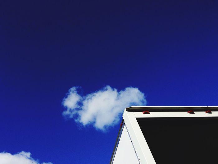 Back of storage van against a blue sky. Truck, van, open, door, sky, copy space, moving, delivery Sky Copyspace Truck Open Moving Moving Van