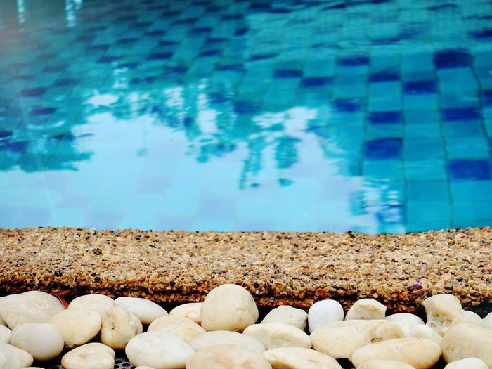 Close-up of stones in swimming pool
