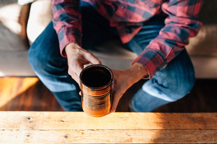 Casual Clothing Close-up Coffee Coffee - Drink Cozy Day Drinking Holding Home Human Hand Indoors  Low Section Men One Person People Real People Sitting Table Wood - Material