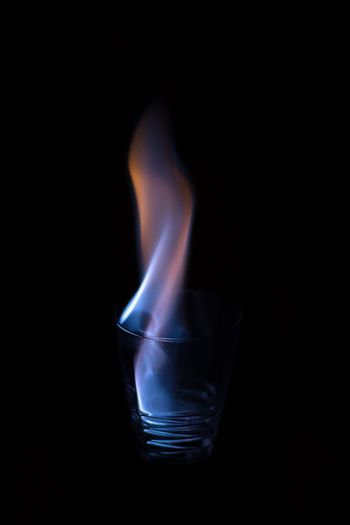 Burning Flame Heat - Temperature Copy Space Glowing Black Background Matchstick Studio Shot Motion Smoke - Physical Structure Swirl No People Illuminated Indoors  Blue Close-up