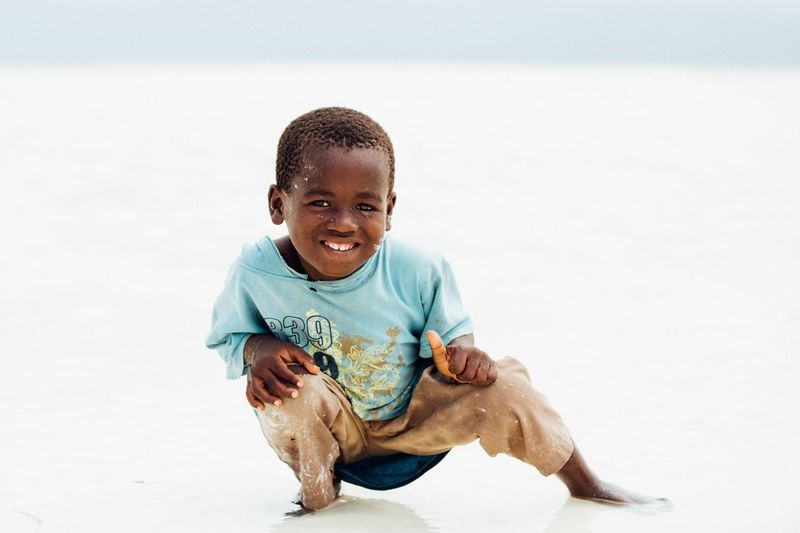 All smiles Happiness Island Tanzania Zanzibar Beautiful Beautifuldestinations Travel One Person Child Childhood Full Length Portrait Front View Sitting Smiling Looking At Camera Cute Casual Clothing Lifestyles Innocence