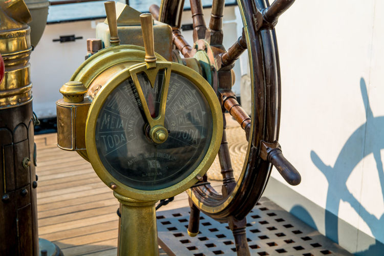 High angle view of ship throttle and steering wheel