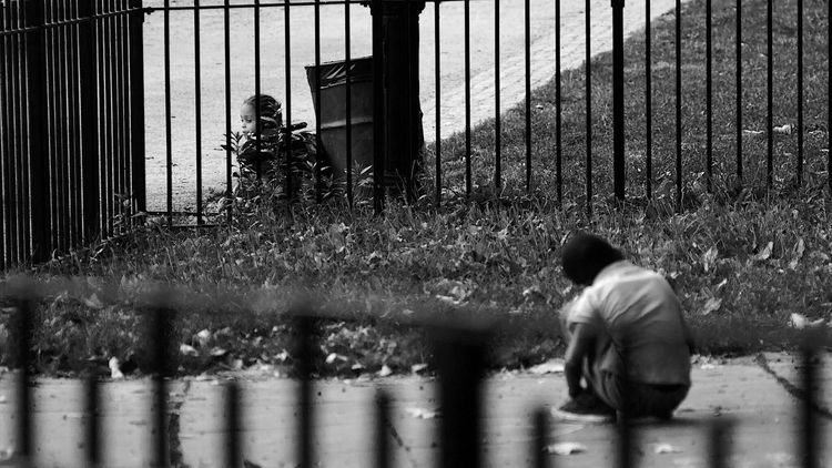 Lonliness Hiding Playground Kids Children Playing NYC Street Photography NYC LIFE ♥ Nycphotographer Fence Railing Casual Clothing Day Outdoors Innocence Person Looking In The Park