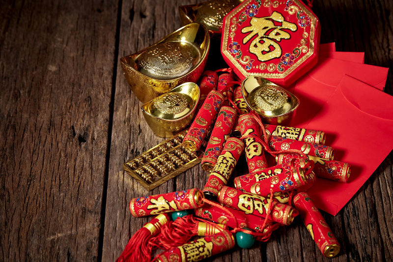 Chinese New Year Lunar New Year Good Luck Decoration Festive Wooden Table Luck Mascot Flat Lay Celebration Craft Firecrackers Ornament Gold China 2020 2019 Pig Minimal Sales Envelope Celebrations Flowers Lucky Tradition Symbol Red Fu Background Festival Spring Holiday Traditional Gold Culture Oriental Fortune Asian  ASIA Packet Plum Blossom Design Celebrate Greeting Prosperity Auspicious Money Happiness Firecracker Ingot Wood - Material Still Life Text Indoors  High Angle View No People Gold Colored Close-up Communication Large Group Of Objects Art And Craft Event