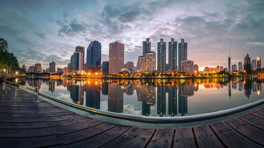 Bangkok city skyline at twilight with water reflection Architecture Building Exterior Built Structure City City Life Cityscape Cloud Cloud - Sky Illuminated Modern Nature No People Office Building Outdoors Reflection Residential District River Sky Skyscraper Tall - High Travel Destinations Urban Skyline Water