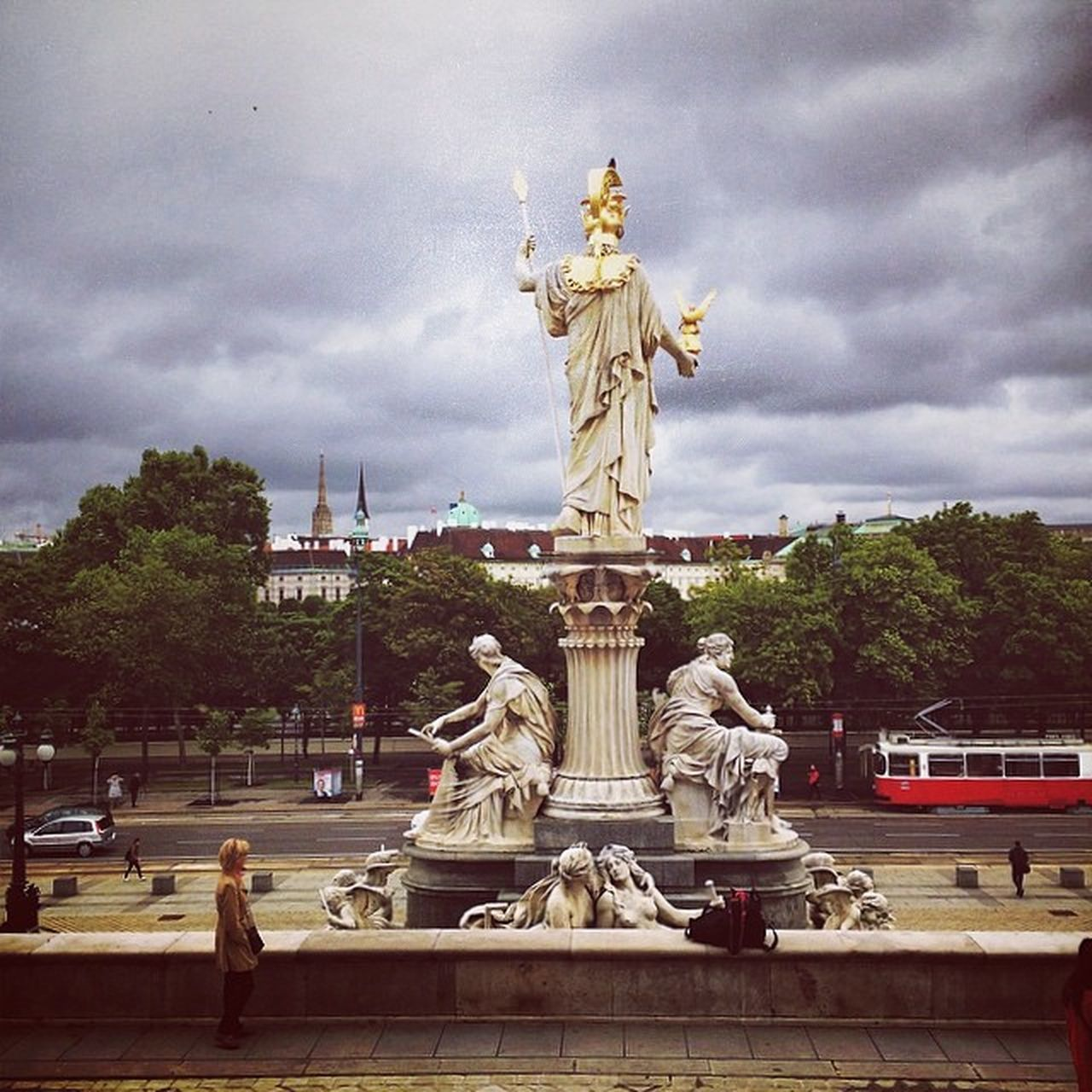 statue, sculpture, cloud - sky, sky, human representation, art and craft, fountain, female likeness, architecture, travel destinations, male likeness, travel, built structure, outdoors, tourism, building exterior, monument, day, city, tree, water, no people