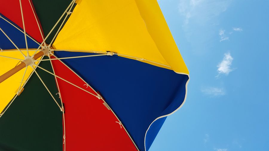 Beach Beach Umbrella Beauty In Nature Blue Close-up Cloud Cloud - Sky Colorful Day Fine Art Photography Low Angle View Multi Colored Nature No People Outdoors Sky Still Life Summer Summertime Sunny Day Tranquility Umbrella Vacation View From Below Yellow Lieblingsteil Live For The Story Sommergefühle Paint The Town Yellow Connected By Travel