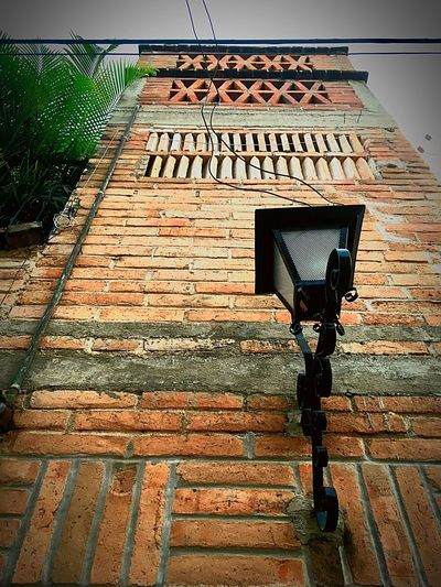 Traditional Mexican architecture Brick Wall Outdoors No People Day Walking Around Architecture Puerto Vallarta Mexican Neighborhoods No People Outdoors Palm Tree Red Tiles Black Lantern Iron Lantern Low Angle View Old Fashioned Light Outdoor Light