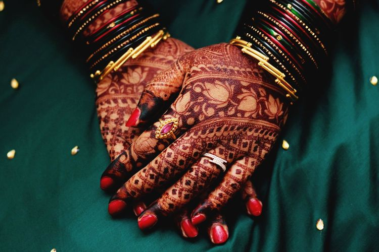 Indian Bridal hands with henna and jewelry. India Indian Indian Culture  Indian Bride Cultures Culture Green Color Henna Mehendi EyeEm Selects Human Hand Bride Sari Bangle Arts Culture And Entertainment Red Wedding Fashion Females Henna Tattoo Painting Fingernails Traditional Ceremony Ring Jewelry Wedding Ceremony Diamond Ring Wedding Ring Life Events