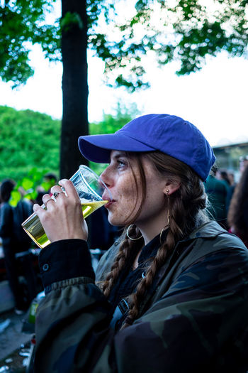 Portrait Of Woman Drinking Beer At A Festival