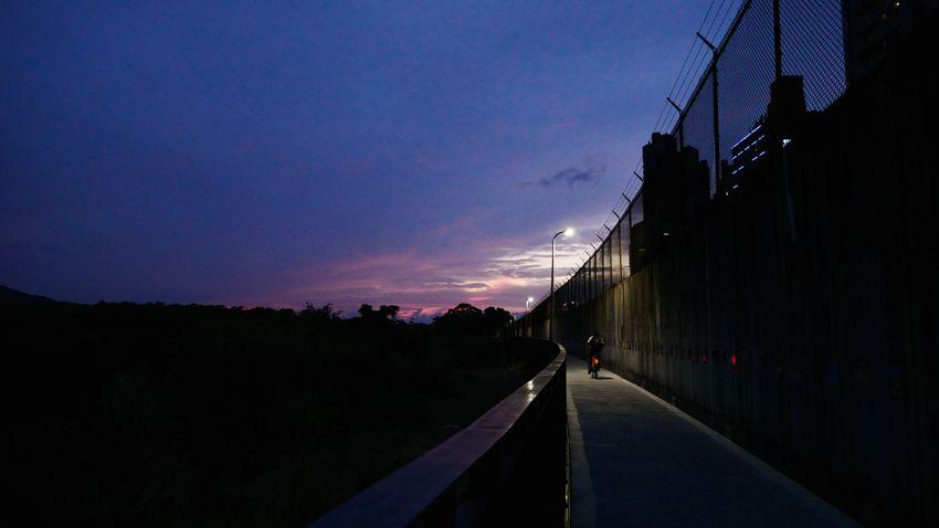 Taiwan Photography Photoishstuffs Tamsui G85 Panasonic  Moody Color EyeEmNewHere Streetphotography Purple Bike Biking Spotlight City Illuminated Silhouette Tree Sky Sunset The Way Forward Dramatic Sky Romantic Sky Atmospheric Mood Moody Sky Adventures In The City