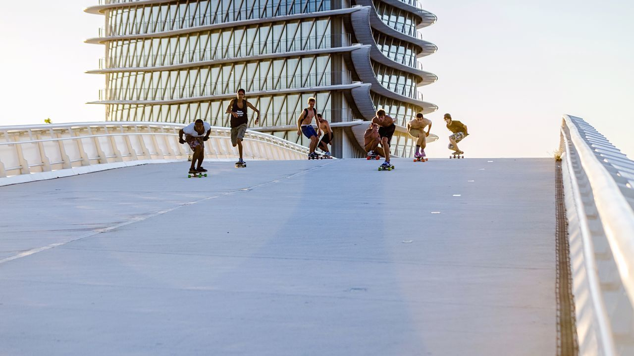 Group of people skateboarding on elevated road