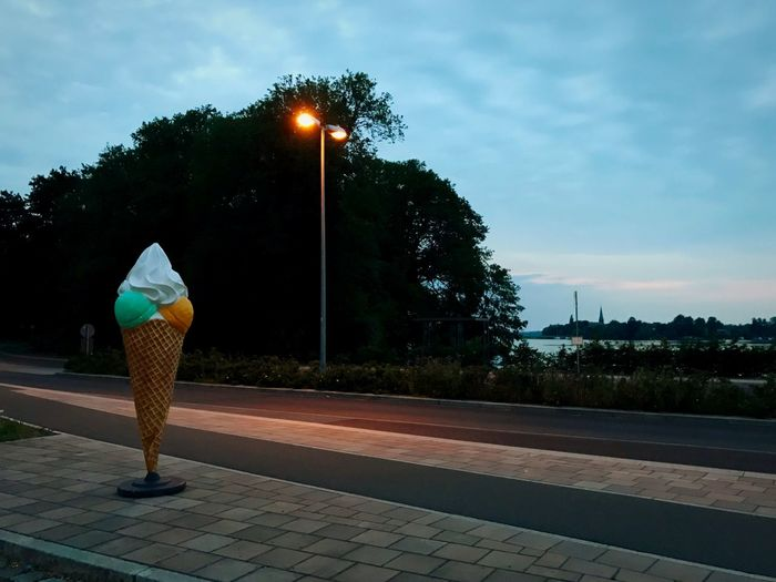 Rear view of woman walking on street at dusk