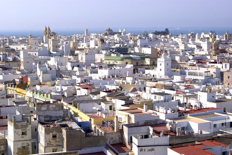 High angle view of white spanish townscape against sky. cadiz, spain
