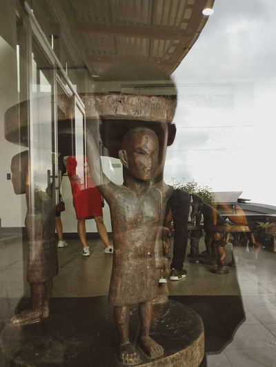 Digital composite image of statue