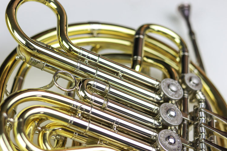 Music Instrument French horn Metal Music Musical Instrument Close-up Arts Culture And Entertainment Indoors  Gold Colored No People Shiny Brass Instrument  Studio Shot Brass Wind Instrument White Background Focus On Foreground Still Life Musical Equipment Silver Colored Selective Focus Trumpet
