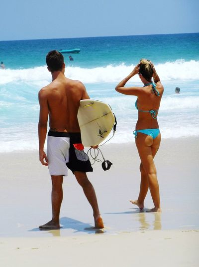 Beach Sea Sand Vacations Two People Togetherness Standing Rear View Bikini Water Leisure Activity Wet Freedom Lifestyle Vacation Time Vitality Rio De Janeiro Surfer Cuple Culture Summer Relaxation Enjoyment Happiness Yolo Uniqueness
