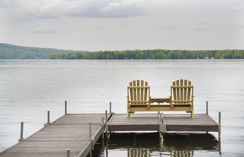 Deckchairs Relaxing Travel Beauty In Nature Chairs Day Lake Nature No People Outdoors Peaceful Pier Scenics Sky Tranquility Water Wood - Material