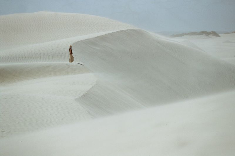 Searching in the sand Cinematic Sand Desert Sand Dune One Person Full Length High Angle View Day Outdoors Arid Climate Real People Landscape Nature Vacations Adventure Go Higher