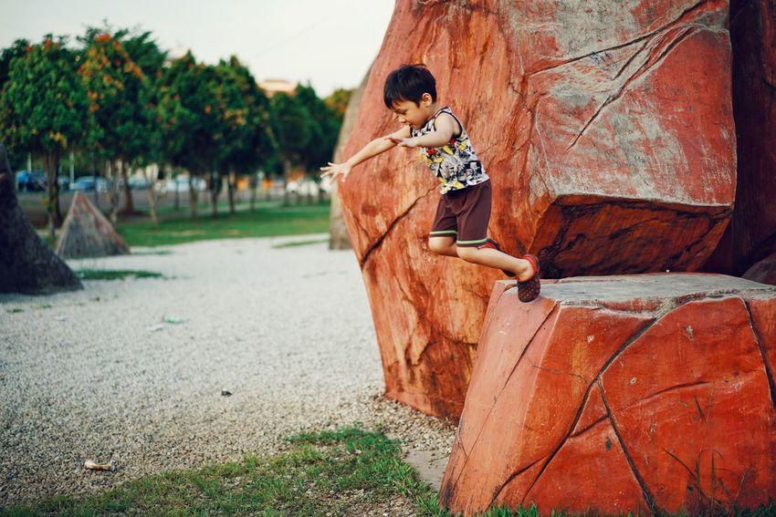 jump out Kidsphotography Kids Being Kids Kids EyeEmNewHere Playing EyeEm Kids Tree Men Full Length Sky Hiker Growing Photographing Photographer Camera