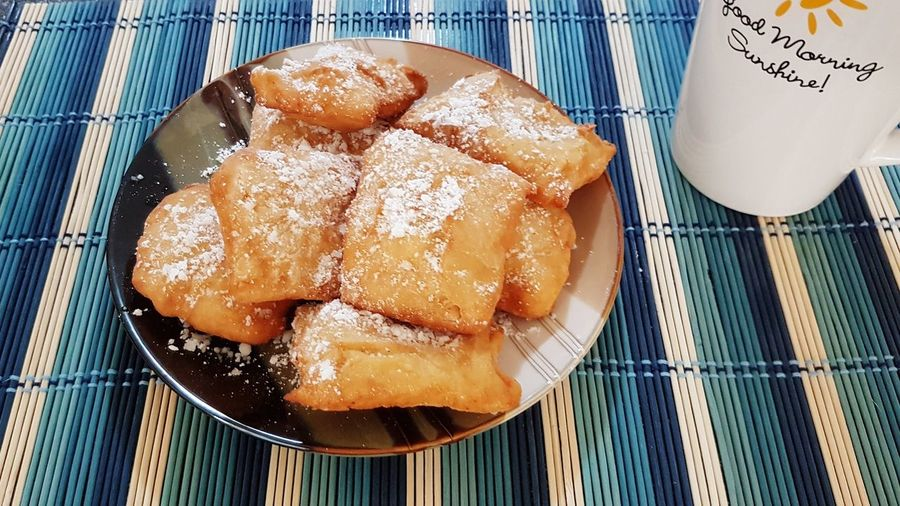 Food And Drink Food High Angle View Ready-to-eat Beignets Aka French Don Beignets Beignets Dusted With Powdered Sugar In Natural Linen Napkin Beignet