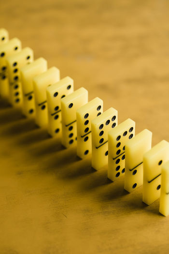 Close-up of dominoes in row on table