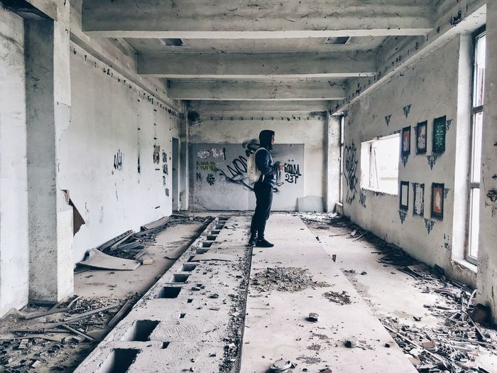 Abandoned Indoors  Full Length Built Structure Lifestyles Architecture One Person Day Adult People Adults Only Live For The Story The Photojournalist - 2017 EyeEm Awards EyeEmNewHere The Street Photographer - 2017 EyeEm Awards Old Ruin Bad Condition The Photojournalist - 2017 EyeEm Awards