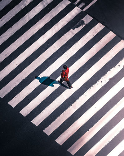 When you reach a crossroad The Street Photographer - 2018 EyeEm Awards Architecture City Crossing Crosswalk Day Full Length High Angle View Marking One Person Pattern Real People Road Road Marking Shadow Sign Street Street Photography Streetphotography Striped Symbol Transportation Week On Eyeem Zebra Crossing Capture Tomorrow