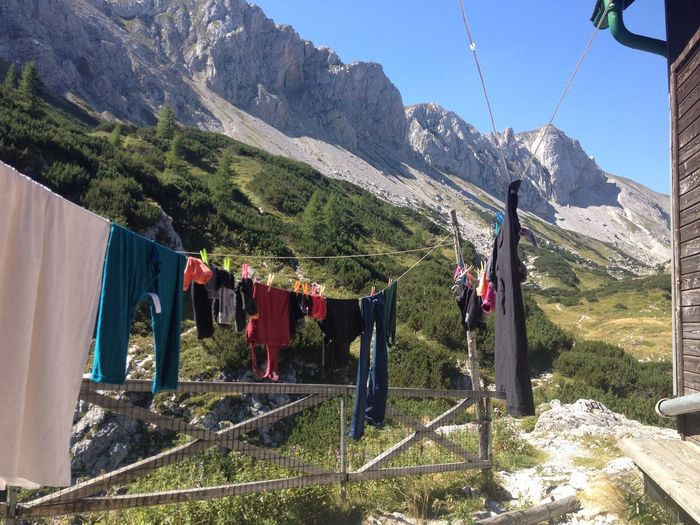Laundry drying in yard against mountains