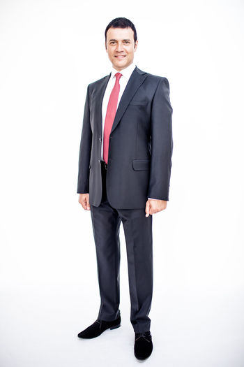 Man in classic suit on the white background. Studio shot. Business Business Stories Adult Business Business Finance And Industry Business Person Businessman Clothing Confidence  Formalwear Full Length Full Suit Looking At Camera Males  Manager Men Menswear One Person Portrait Smiling Standing Studio Shot Suit Well-dressed White Background