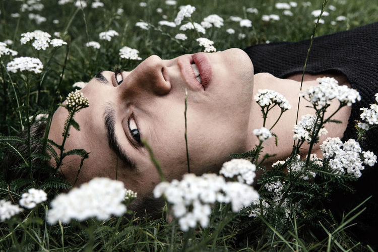 Bartek in Berlin. Summer 2016 Beautiful People Beauty Beauty In Nature Day Day Dreaming Face Flower Grass Green Healthy Leasure Activity Leasure Time Lying Down Lying On Back Male Model Nature One Person Outdoors Portrait Wildflower Young Adult Uniqueness Fresh On Market 2017