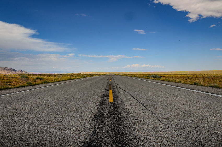 A lonely road in the southwest of the United States Asphalt Country Road Diminishing Perspective Empty Empty Road Endless Road Horizon Over Land Lonely Road No People Outdoors Road Surface Level Vanishing Point