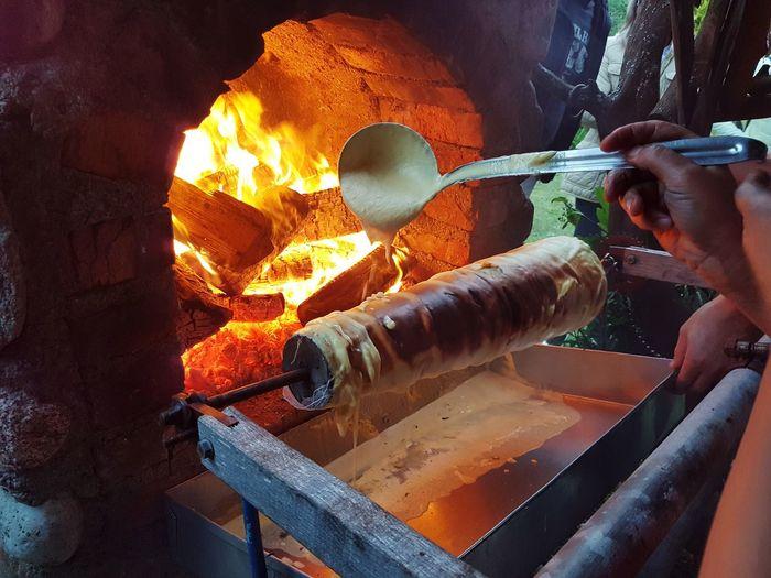 Lithuanian Food Šakotis EyeEm Selects Human Hand Working Flame Heat - Temperature Burning Close-up Food And Drink