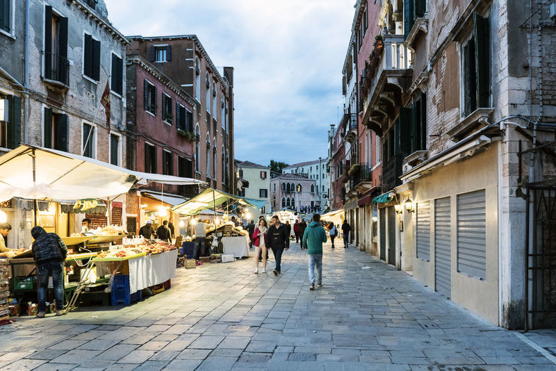Walking along the narrow streets and canals of Venice, Italy Architecture Building Exterior Built Structure Canal City Day Europe Gondola Italy, Landmarkbuildings Large Group Of People Men Outdoors People Real People Sky Street Travel Destinations Venetian Venice, Italy Walking