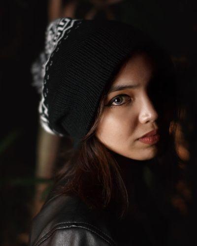 Close-up portrait of beautiful woman wearing knit hat