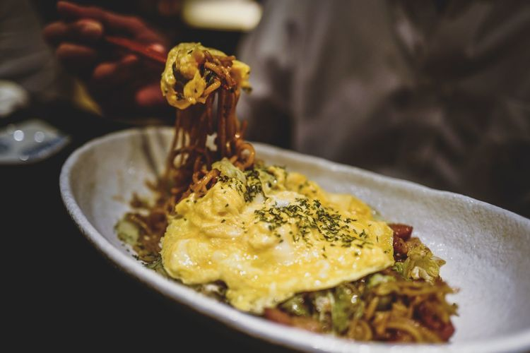 Close-Up Of Fried Noodles With Omelet