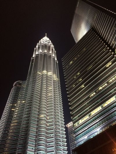Architecture Night Skyscraper Low Angle View Modern Tower Tall - High Building Exterior Illuminated Built Structure City Sky Tall Office Building Spire  Travel Destinations Petronas Towers  Capital Cities  Building Story Dark First Eyeem Photo